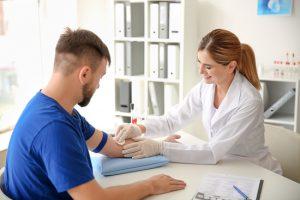 doctor getting blood sample