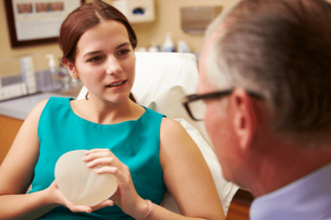 patient holding breast implants