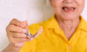 Granda wil definitely smile again through her partial dentures.